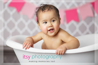 Newborn photographer, baby photography, infant photography, one year old girl, studio photography, cake smash, grey wallpaper backdrop, pink banner, baby bathtub, bath time,