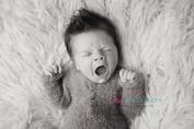 Newborn photographer, baby photographer, newborn, boy, infant,, newborn posing ideas, white flokati, fuzzie onsie, mohawk, yawning