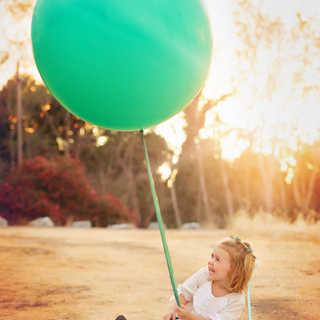 Becca and the Balloon sitting.jpg