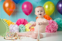 Cake Smash, First Year, first birthday, baby boy, one year old, rainbow, confetti. colorful. pom poms, balloons, rainbow cake, confetti cake, blue backdrop, smiling, happy birthday, baby photographer, one year old posing ideas, dc photographer, photography
