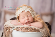 Newborn photographer, baby photography, infant photography, newborn girl, cream lace bonnet, lace, cream wrap , sequins, white bucket, neutral colors, ,  head on hands pose, newborn posing ideas