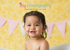 baby photographer, orange backdrop, pink banner, baby girl, first birthday, one year old