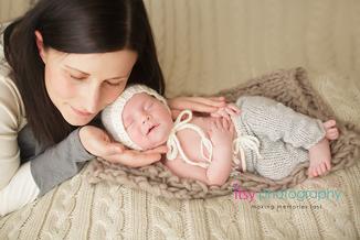 Newborn photographer, baby photography, infant photography, newborn boy,  on back, cream blanket knit backdrop, brown blanket, eyes open, new born posing ideas, white hat, grey pants, sleeping, mom