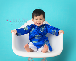 Baby photographer, family photographer, toddler boy, Asian clothes, blue backdrop, white chair