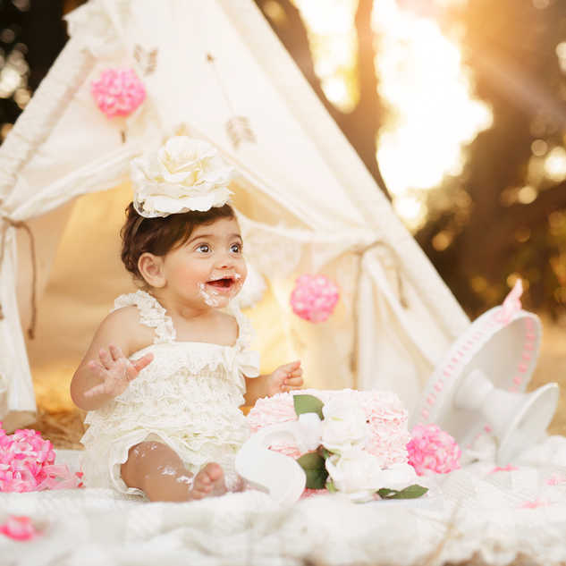 baby girl pink cream cake smash outdoors