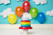 baby photographer, rainbow cake smash, rainbow cake, one year old boy, cloud backdrop, red cake stand