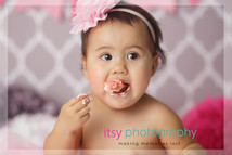 Newborn photographer, baby photography, infant photography, one year old girl, studio photography, cake smash, rosette floral cake, pop poms, grey wallpaper backdrop, pink banner,white cake stand, pink tutu