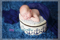 Newborn photographer, baby photography, infant photography, newborn boy, grey flokati, blue wrap, baby wrapping, newborn posing ideas, white chair, banner, blue backdrop, nautical