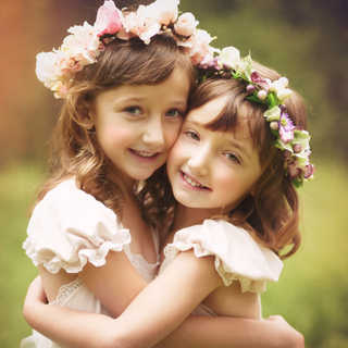 two sisters with flower wreaths.jpg
