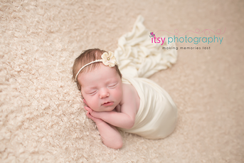 Newborn photographer, baby photography, infant photography, newborn girl, white blankets, newborn posing ideas, white wrap,  floral headband, neutral colors