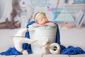Newborn photographer, baby photography, infant photography, newborn girl, blue wrap,blue balnket, white bucket, nautical backdrop, boats, sea, anchor, blue head, floral head band, head on hands pose, newborn posing ideas