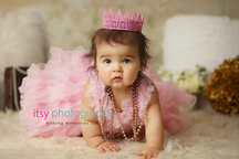 baby photographer, newborn photographer, infant photographer, dc photographer, 1 year old one year old posing ideas, cake smash, pink dress, pink crow, pink and gold, white flokati