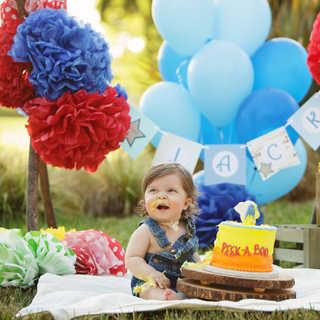 outdoor cake smash baby boy trach peek a