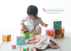 baby photographer, blocks, white backdrop, blanket, pajamas, baby girl, one year old, first birthday