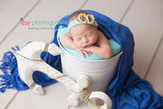 Newborn photographer, baby photography, infant photography, newborn girl, blue wrap,blue balnket, white bucket, nautical backdrop, boats, sea, anchor, blue head, floral head band, head on hands pose, newborn posing ideas , white floor backdrop
