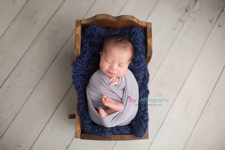 Newborn photographer, baby photography, infant photography, newborn boy, newborn posing ideas, small cradle, grey wrap, white floor