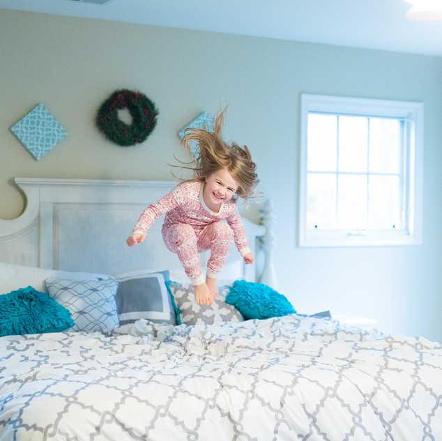 IMG_8791 Becca jumping christmas bed.jpg