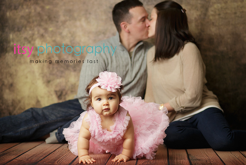 baby photographer, newborn photographer, infant photographer, dc photographer, 1 year old one year old posing ideas, pink dress, white chair, brown backdrop, mom and dad