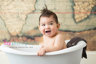baby photographer, towel, map backdrop, wood floor, white towel, happy baby, first birthday, baby boy, cake smash , dc photographer, family photographer, bath time, baby bathtub