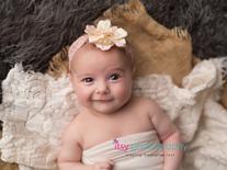 Newborn photographer, baby photography, infant photography, newborn girl, flower headband, baby wrapping, smiling baby, eyes open, burlap, lace, flokati, newborn posing ideas