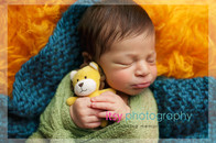 Newborn photographer, baby photography, infant photography, newborn boy, green wrap, baby wrapping, lion stuffed animal, orange flokati