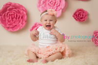 Newborn photographer, baby photography, infant photography, One year old, Sitter Session, Pink flowers, pink tutu, lace, happy birthday, cake smash, pink flower headband, crying, baby girl