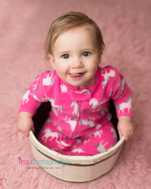 Cake smash, one year old girl, baby girl, baby photographer, newborn photographer, infant photographer,  pink flokati, unicorn footie pajamas