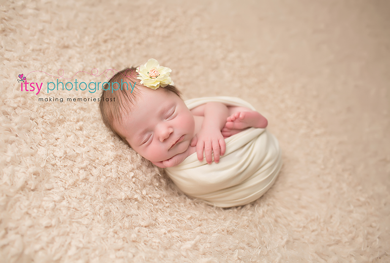 Newborn photographer, baby photography, infant photography, newborn girl, white blankets, newborn posing ideas, neutral colors, floral headband, cream wrap, baby wrapping, newborn wrapping