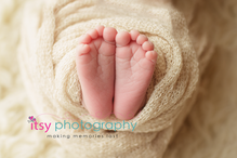Newborn photographer, baby photography, infant photography, newborn boy, cream wrap, baby wrapping, cream flokati, white backdrop,  toes, feet