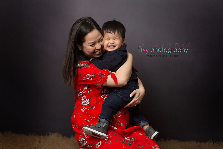 Maternity photography,  floral  maternity dress, studio session,  newborn photographer, maternity posing ideas, mom , black backdrop, red maternity dress, mom and son  toddler, big brother, black and white