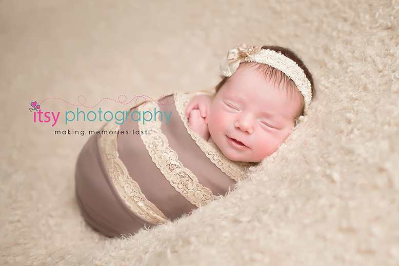 Newborn photographer, baby photography, infant photography, newborn girl, white blankets, newborn posing ideas, neutral colors, floral headband, grey and lace wrap, baby wrapping, newborn wrapping