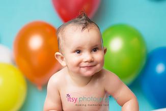 baby photographer, one year old, boy, bath, rainbow balloons, blue backdrop