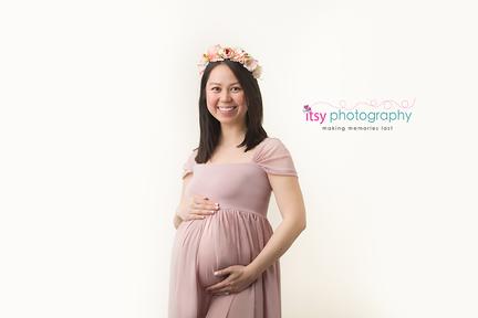 Maternity photography, mauve maternity dress, studio session,  newborn photographer, maternity posing ideas, mom , cream backdrop, maternity dress, floral crown