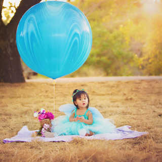 big large huge balloon baby girl field o
