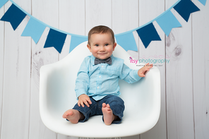 baby photographer, one year old boy, blue banner, white chair, white wood backdrop