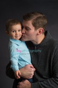 baby photographer, family, dad, son, blue button up, black backdrop