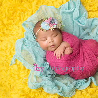 3G2B2583 yellow blue pink swaddled baby