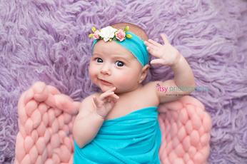 Newborn photographer, baby photography, infant photography, newborn girl, blue wrap, blue headband, pink blanket, lavander flokati, baby wrapping, eyes open,