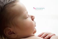 Baby photographer, newborn photographer, infant photographer, details. cheeks, boy, baby, white background, fingers, nose, eyelashes