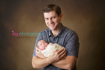 Newborn photographer, baby photography, infant photography, newborn boy, dad, cream wrap, baby wrapping, cream flokati, white backdrop, family,  mom and dad, brown backdrop