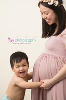 Maternity photography, mauve maternity dress, studio session,  newborn photographer, maternity posing ideas, mom and son, cream backdrop