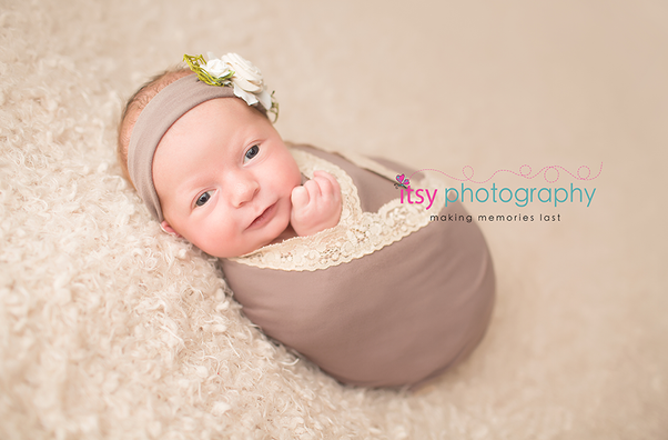 Newborn photographer, baby photography,, eyes open, awake infant photography, newborn girl, whtie backdrop, grey wrap, floral headband, baby wrapping lace wrap, grey headband , head on hands pose, newborn posing ideas
