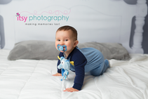 baby photographer, bed backdrop, pajamas, pacifier