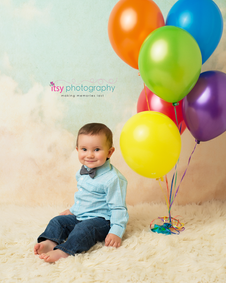 baby photographer, balloons, cloud backdrop, one year old boy
