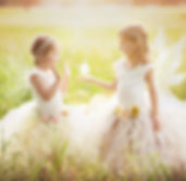 Two sisters in a field with kissing fair