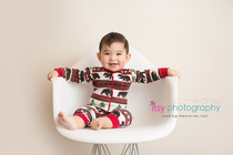 baby photographer, family photographer, dc photographer, ugly sweater pajamas, bear pajamas, white chair, white backdrop, baby boy, one year old, first birthday, baby posing ideas