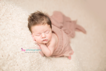 Newborn photographer, baby photographer, newborn, boy, infant, newborn posing ideas, army, cream blanket, head on hands pose, mohawk, mom , cream wrap