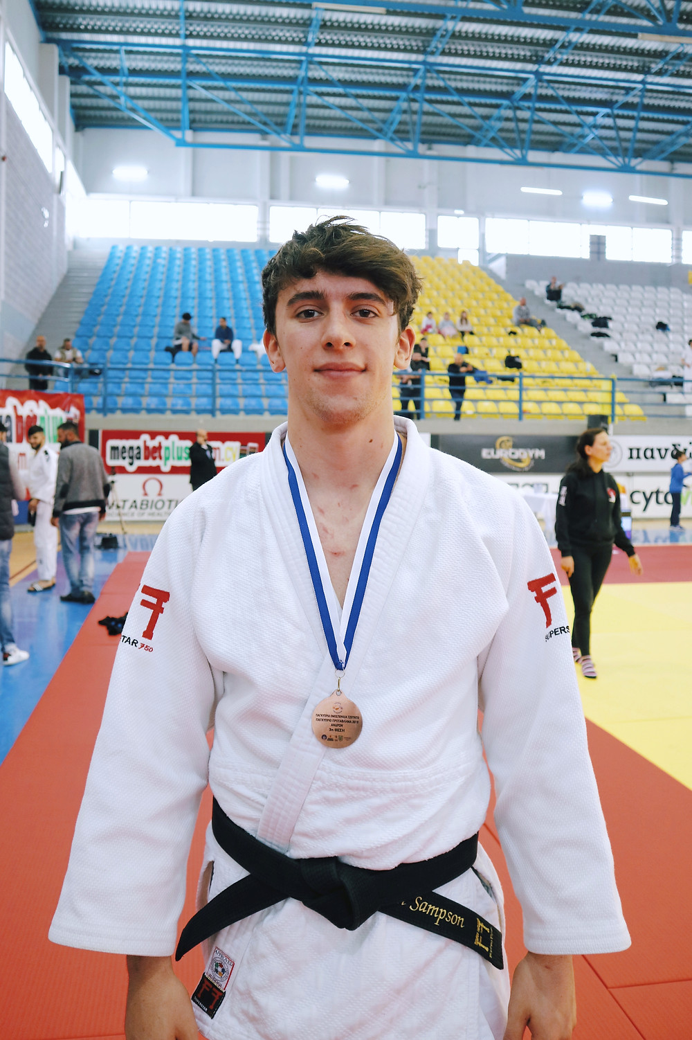 Sam Sampson with his medal