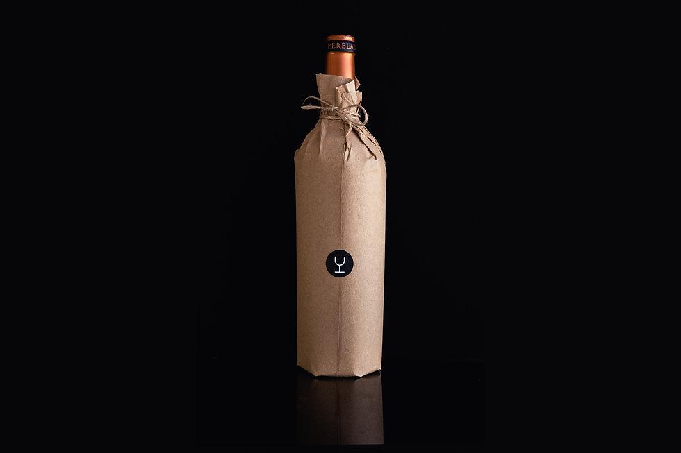 Botella_en_Kraft_sin_nada_más_que_la_co