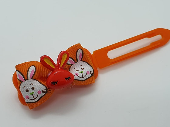 Orange Easter Bunny Face on a Bunny Patterned Bow on a Orange 4.5 Clip